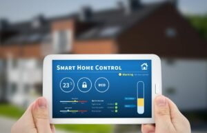 Hands Holding Tablet in Front of House for Smart Home Installation Services in Sunrise