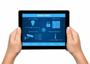 Hands Holding Tablet with Smart Home Installation Services in Sunrise