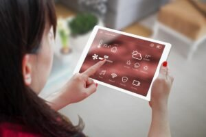 Woman Holding Tablet with Smart Home Installation Services in Weston